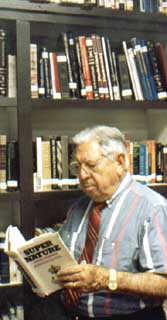 Jose Silva with part of his vast library of metaphysical and scientific books. The World's Number 1 researcher in the field of intuition and ESP, he studied remote viewing, ESP, psychi ability, clairvoyance, intuition, precognition, hypnosis, yoga, Zen, alpha brain waves, theta brain waves, delta brain waves, and more.